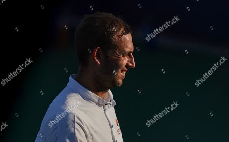 Dan Evans of Great Britain reacts during play in the Men's Doubles
