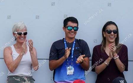 Judy Murray reacts alongside Jamie Murray ?s wife Alejandra Murray (right), in the stands after Jamie Murray of Great Britain hits a backhand over-shoulder smash winner during play in the Men?s Doubles.