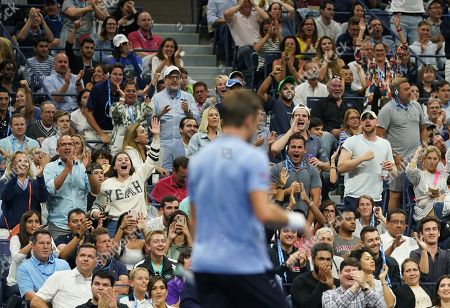 Stock Picture of Stan Wawrinka (SUI) is cheered by the New York fans as he wins the 2nd set