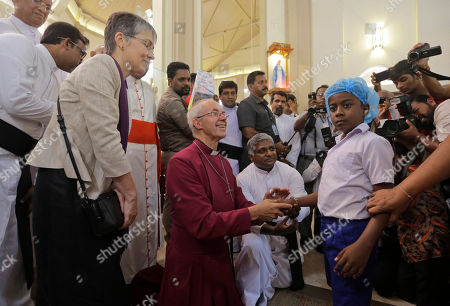 The Archbishop of Canterbury Justin Welby blesses a survivor of the Easter Sunday attack at St. Sebastian's church in Katuwapitiya village, Negombo, Sri Lanka, . More than 250 people were killed in coordinated suicide bomb attacks at three churches and three tourist hotels on Easter Sunday that were claimed by the Islamic State group and carried out by a local radicalized Muslim group