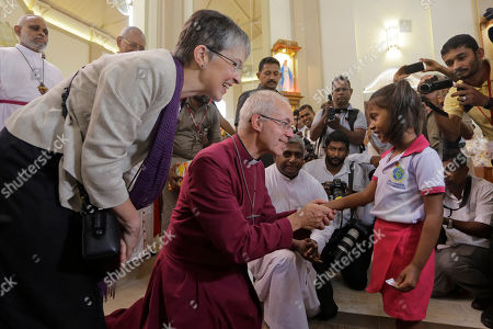 The Archbishop of Canterbury Justin Welby blesses a survivor of the Easter Sunday attacks at St. Sebastian's church in Katuwapitiya village, Negombo, Sri Lanka, . More than 250 people were killed in coordinated suicide bomb attacks at three churches and three tourist hotels on Easter Sunday that were claimed by the Islamic State group and carried out by a local radicalized Muslim group