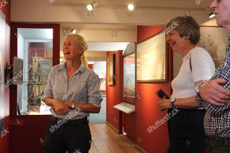 Mary Montagu-Scott shows Theresa and Philip May around the Maritime Museum at Buckler's Hard