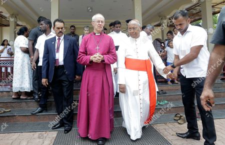 The Archbishop of Canterbury Justin Welby, center, and Cardinal Malcolm Ranjith, the archbishop of Colombo, right, leave the St. Sebastian's church, one of the sites of the Easter Sunday attacks, in Katuwapitiya village, Negombo, Sri Lanka, . The figurehead of the Church of England emphasized the need for Christian unity on Thursday as he paid tribute to the victims of the Easter Sunday bomb attacks at the Roman Catholic church. A total of 263 people were killed when seven suicide bombers from a local Muslim group attacked three churches and three luxury hotels on April 21