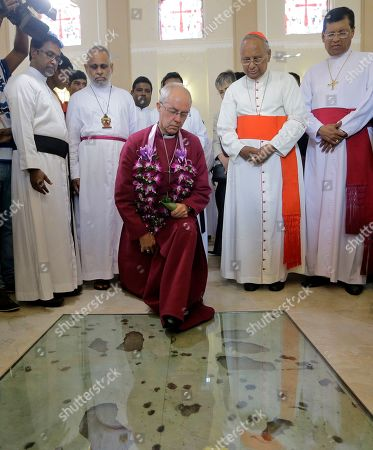 The Archbishop of Canterbury Justin Welby pays homage to victims of the Easter Sunday attacks, kneeling at the spot where the suicide bomber detonated explosives, at St. Sebastian's church in Katuwapitiya village, Negombo, Sri Lanka, . The figurehead of the Church of England emphasized the need for Christian unity on Thursday as he paid tribute to the victims of the Easter Sunday bomb attacks at the Roman Catholic church. A total of 263 people were killed when seven suicide bombers from a local Muslim group attacked three churches and three luxury hotels on April 21