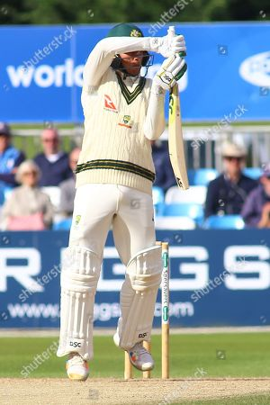 Usman Khawaja of Australia fends off a short delivery during the Tour Match match between Derbyshire County Cricket Club and Australia at the Pattonair County Ground, Derby