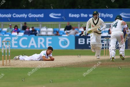 Usman Khawaja of Australia plays the ball back past Alfie Gleadall of Derbyshire during the Tour Match match between Derbyshire County Cricket Club and Australia at the Pattonair County Ground, Derby