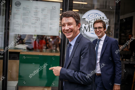 French Member of the La Republique En Marche (LaREM) party and candidate for Paris' 2020 Municipal Election Benjamin Griveaux (C) and his campaign director Pacme Rupin leave a press conference in Paris, France, 29 August 2019.
