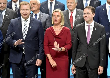 Finnish Minister of Defence Antti Kaikkonen (L), High Representative of the European Union for Foreign Affairs and Security Policy and Vice-President of the European Commission Federica Mogherini and Finnish Commissioner of Jobs, Growth, Investment and Competitiveness Jyrki Katainen