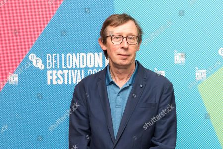kevin Loader poses for photographers on arrival at the programme launch for the London Film Festival in central London on . The annual festival will run from the 2 to 13 October