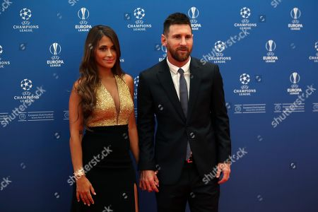Barcelona's soccer player Lionel Messi and his wife Antonella Roccuzzo pose to the photographers before the UEFA Champions League group stage draw at the Grimaldi Forum, in Monaco