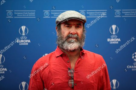 French former soccer star Eric Cantona poses to the photographers before the UEFA Champions League group stage draw at the Grimaldi Forum, in Monaco