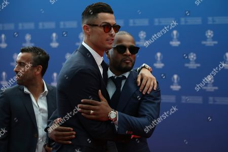 Stock Picture of Juventus' soccer player Cristiano Ronaldo, left, and French former soccer player Patrice Evra pose for the photographers before the UEFA Champions League group stage draw at the Grimaldi Forum, in Monaco