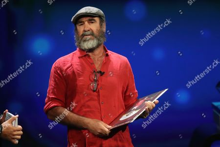 French former soccer star Eric Cantona receives the UEFA President's Award during the Champions League group stage draw at the Grimaldi Forum, in Monaco
