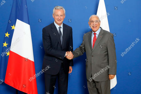 French Finance Minister Bruno Le Maire, left, meets with OECD chief Angel Gurria to plan for international taxes on digital giants like Amazon and Google at Bercy Economy ministry in Paris, . France recently introduced a 3% tax on the companies' French revenues, prompting U.S. President Donald Trump to threaten tariffs on French wine in response