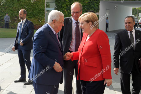 Palestinian President Mahmoud Abbas meets with German Chancellor Angela Merkel