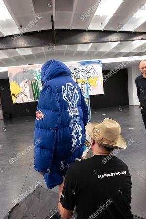 Danny Minnick paints a jacket
