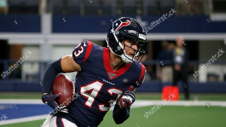 Houston Texans safety Chris Johnson (43) carries the ball during warm ups before a preseason NFL football game against the Dallas Cowboys in Arlington, Texas