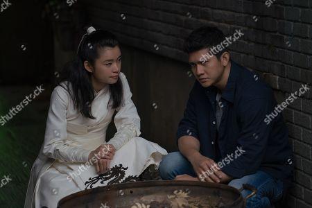 Celia Au as Ying Ying and Iko Uwais as Kai Jin