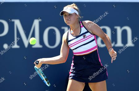 Sofia Kenin, of the United States, returns a shot to Laura Siegemund, of Germany, during the second round of the US Open tennis championships, in New York