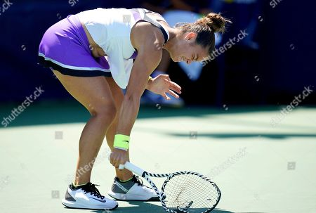 Stock Picture of Maria Sakkari, of Greece, smashes her racket on the court after losing a point to Peng Shuai, of China, during the second round of the US Open tennis championships, in New York