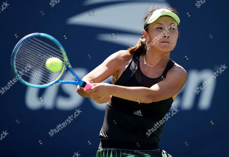 Stock Image of Peng Shuai, of China, returns a shot to Maria Sakkari, of Greece, during the second round of the US Open tennis championships, in New York