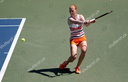 Alison Van Uytvanck, of Belgium, returns a shot to Wang Qiang, of China, during the second round of the US Open tennis championships, in New York