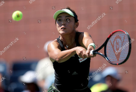 Wang Qiang, of China, returns a shot to Alison Van Uytvanck, of Belgium, during the second round of the US Open tennis championships, in New York