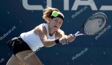 Karolina Muchova, of the Czech Republic, returns a shot to Hsieh Su-Wei, of Taiwan, during the second round of the US Open tennis championships, in New York