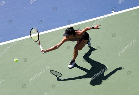 Hsieh Su-Wei, of Taiwan, returns a shot to Karolina Muchova, of the Czech Republic, during the second round of the US Open tennis championships, in New York