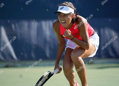 Zhang Shuai, of China, reacts after defeating Ekaterina Alexandrova, of Russia, during the second round of the US Open tennis championships, in New York