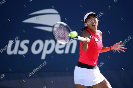Zhang Shuai, of China,returns a shot to Ekaterina Alexandrova, of Russia, during the second round of the US Open tennis championships, in New York