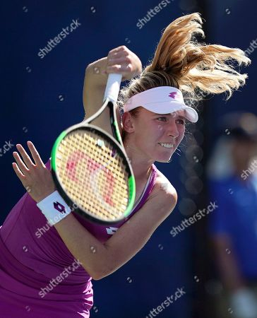 Ekaterina Alexandrova, of Russia, serves to Zhang Shuai, of China, during the second round of the US Open tennis championships, in New York