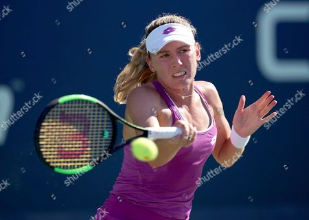 Ekaterina Alexandrova, of Russia, returns a shot to Zhang Shuai, of China, during the second round of the US Open tennis championships, in New York