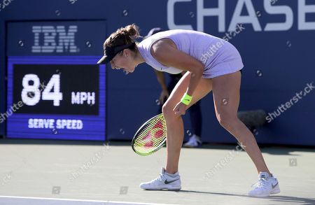 Belinda Bencic, of Switzerland, reacts after scoring a point against Alize Cornet, of France, during the second round of the US Open tennis championships, in New York