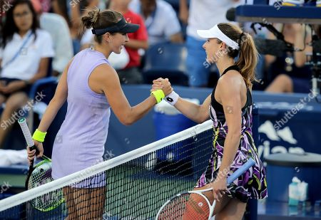 Belinda Bencic, left, of Switzerland, greets Alize Cornet, of France, after winning their second round match of the US Open tennis championships, in New York