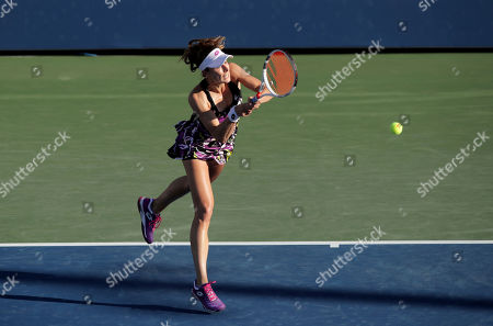 Alize Cornet, of France, returns a shot to Belinda Bencic, of Switzerland, during the second round of the US Open tennis championships, in New York