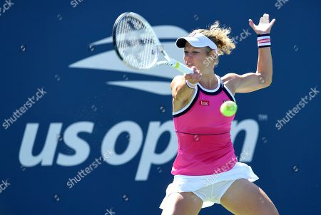 Laura Siegemund, of Germany, returns a shot to Sofia Kenin, of the United States, during the second round of the US Open tennis championships, in New York