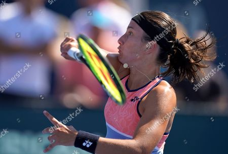 Anastasija Sevastova, of Latvia, returns a shot to Iga Swiatek, of Poland, during the second round of the US Open tennis championships, in New York