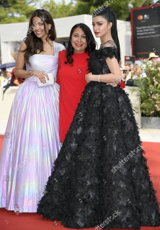 Saudi actress Mila Al-Zahrani, Saudi movie director HaifaA Al-Mansour and Saudi actress Dhay arrive for the premiere of 'The Perfect Candidate' during the 76th annual Venice International Film Festival, in Venice, Italy, 29 August 2019. The movie is presented in the official competition 'Venezia 76' at the festival running from 28 August to 07 September.