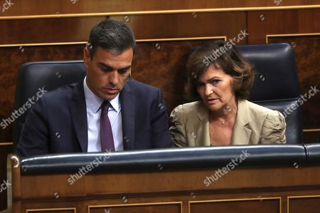 Spanish acting Prime Minister Pedro Sanchez (L) and acting Vice president Carmen Calvo (R) attend an extraordinary plenary session on the Open Arms crisis at the Spanish Lower House in Madrid, Spain, 29 August 2019. The main parliamentary opposition groups will evaluate PSOE's (Spanish Socialist Workers Party) management of the humanitarian ship situation, including interventions of Cayetana Alvarez de Toledo (Popular Party), Ines Arrimadas (Ciudadanos) and Santiago Abascal (Vox).
