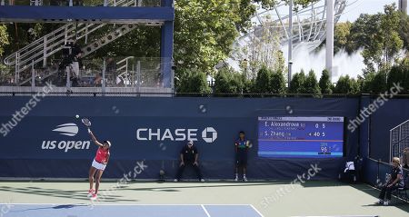 Zhang Shuai of China serves to Ekaterina Alexandrova of Russia during their match on the fourth day of the US Open Tennis Championships the USTA National Tennis Center in Flushing Meadows, New York, USA, 29 August 2019. The US Open runs from 26 August through 08 September.