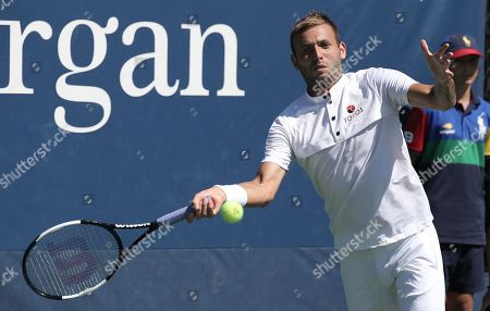 Daniel Evans of Great Britain hits a return to Lucas Pouille of France during their match on the fourth day of the US Open Tennis Championships the USTA National Tennis Center in Flushing Meadows, New York, USA, 29 August 2019. The US Open runs from 26 August through 08 September.