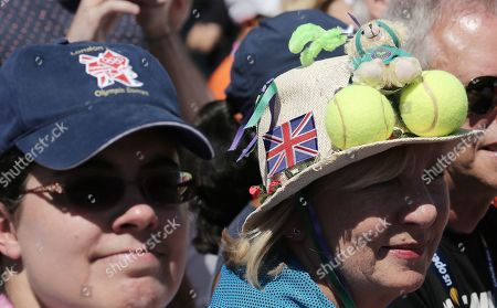 Stock Picture of Fans wearing hats with British icons on them as they watch Lucas Pouille of France play Daniel Evans of Great Britain during their match on the fourth day of the US Open Tennis Championships the USTA National Tennis Center in Flushing Meadows, New York, USA, 29 August 2019. The US Open runs from 26 August through 08 September.