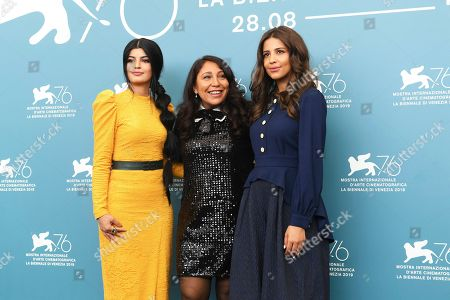 Dhay, Haifaa Al Mansour, Khalid Abdulrhim, Mila Alzahrani. Actress Dhay, from left, director Haifaa Al Mansour, and actress Khalid Abdulrhim poses for photographers at the photo call for the film 'The Perfect Candidate' at the 76th edition of the Venice Film Festival in Venice, Italy