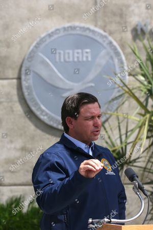 Florida Gov. Ron DeSantis speaks about Tropical Storm Dorian outside of the the National Hurricane Center, in Miami