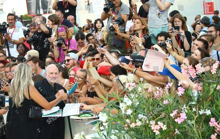 Brian De Palma poses for photographers upon arrival at the premiere of the film 'Marriage Story' at the 76th edition of the Venice Film Festival, Venice, Italy