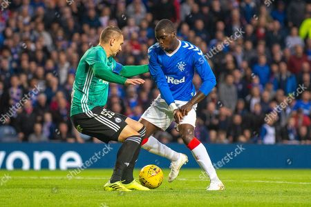 Sheyi Ojo (#11) of Rangers FC steps inside Artur Jedrzejczyk (#55) of Legia Warsaw during the Europa League Play Off leg 2 of 2 match between Rangers FC and Legia Warsaw at Ibrox Stadium, Glasgow