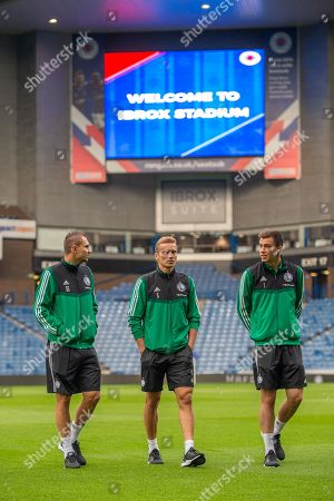 Artur Jedrzejczyk (#55), Igor Lewczuk (#5) and Radoslaw Majecki (#1) of Legia Warsaw on the pitch before the Europa League Play Off leg 2 of 2 match between Rangers FC and Legia Warsaw at Ibrox Stadium, Glasgow