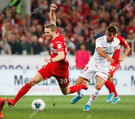 Stock Image of Andre Schuerrle (L) of Spartak in action against Andre Horta (R) of Braga during the UEFA Europa League playoff, second leg soccer match between Spartak Moscow and Sporting Braga in Moscow, Russia, 29 August 2019.
