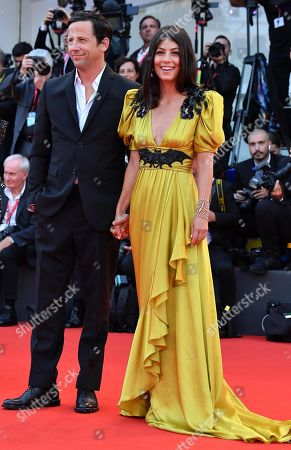 Stock Picture of Alessandra Mastronardi (R) and her fiance Ross McCall (L) arrive for the premiere of 'Marriage Story' during the 76th annual Venice International Film Festival, in Venice, Italy, 29 August 2019. The movie is presented in the official competition 'Venezia 76' at the festival running from 28 August to 07 September.